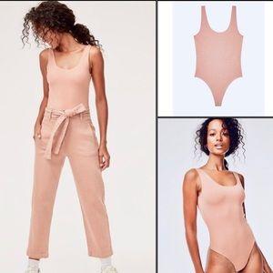 Aritzia baby pink body suit